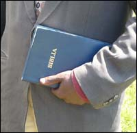 Swahili Union Version Bible in the hands of a pastor